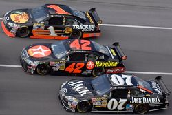 Clint Bowyer, Juan Pablo Montoya and Martin Truex Jr.