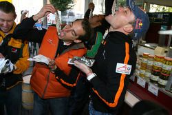 Jeroen Bleekemolen, driver of A1 Team Netherlands and Robert Doornbos, driver of A1 Team Netherlands trying out herrings