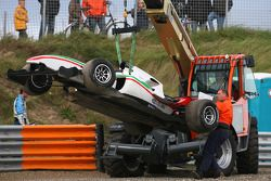 Car of Fabio Onidi , driver of A1 Team Italy being lifted off the track after stopping in the gravel