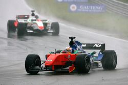 Adrian Zaugg, driver of A1 Team South Africa leads Daniel Morad, driver of A1 Team Lebanon