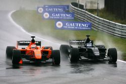 Jeroen Bleekemolen, driver of A1 Team Netherlands and Earl Bamber, driver of A1 Team New Zealand side-by-side fighting for the lead of the race