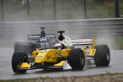 Fairuz Fauzy, driver of A1 Team Malaysia leads Earl Bamber driver of A1 Team New Zealand
