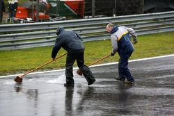 Marshalls trying to clear a river of water off the track