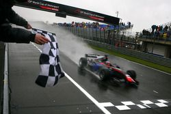 Race winner Loic Duval, driver of A1 Team France taking the chequered flag