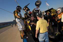 Crew members of Tom Hessert III wait for a pit stop