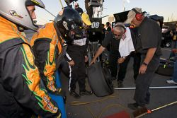 Crew member of Tom Hessert III after a pit stop