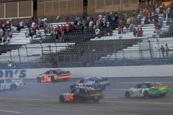 Chrissy Wallace spins in front of Max Dumarey, Mike Harmon, Dexter Bean and Matt Carter