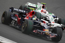 Sebastian Vettel, Scuderia Toro Rosso, STR03 leads Rubens Barrichello, Honda Racing F1 Team, RA108
