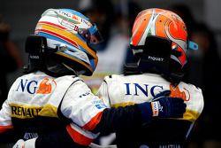 Race winner Fernando Alonso celebrates with Nelson A. Piquet