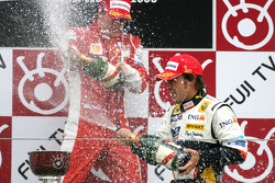 Podium: champagne for Fernando Alonso and Kimi Raikkonen