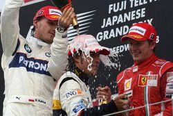 Podium: champagne for Fernando Alonso, Robert Kubica and Kimi Raikkonen