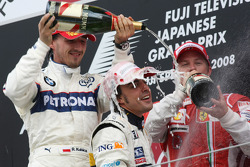 Podium: champagne for Fernando Alonso, Robert Kubica and Kimi Raikkonen