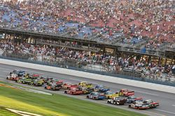 The field races thru the tri-oval