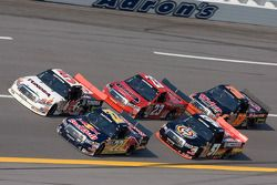 Scott Speed and Mike Skinner lead a pack into turn four