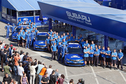 The fifty four team members and three Imprezas of Subaru World Rally Team before the start of Rallye de France Tour de Corse