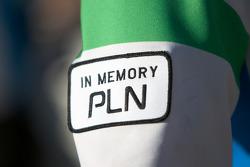 Newman Wachs Racing team members wear a 'In Memory PLN' sign