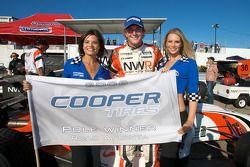 Pole winner Jonathan Summerton celebrates with two lovely Cooper Tires girls