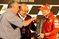 Casey Stoner receives his replica version of the premier-class trophy in recognition of his 2007 Wor