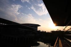 sun sets over padok