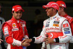 Pole winner Lewis Hamilton celebrates with Felipe Massa