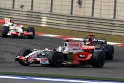 Adrian Sutil, Force India F1 Team, VJM-01 leads Sébastien Bourdais, Scuderia Toro Rosso, STR03
