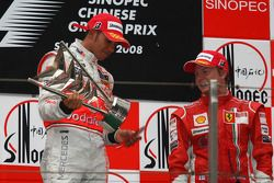 Podium: race winner Lewis Hamilton with the trophy which fell apart
