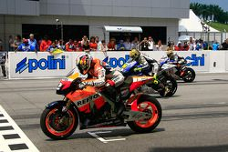 Dani Pedrosa, Valentino Rossi and Jorge Lorenzo on the front row