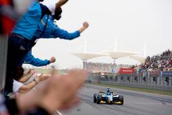 Davide Valsecchi crosses the line to take victory