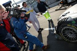 The damaged car of Markus Winkelhock, Audi Sport Team Rosberg, Audi A4 DTM being brought back to the