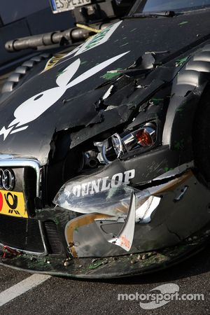 The damaged car of Markus Winkelhock, Audi Sport Team Rosberg, Audi A4 DTM being brought back to the pitlane by truck
