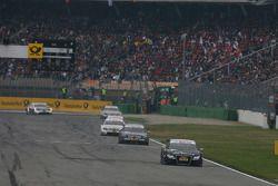 Timo Scheider, Audi Sport Team Abt, Audi A4 DTM, leads Paul di Resta, Team HWA AMG Mercedes, AMG Mer