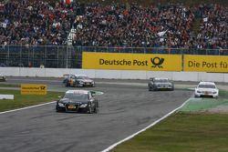 Timo Scheider, Audi Sport Team Abt, Audi A4 DTM leads Jamie Green, Team HWA AMG Mercedes, AMG Merced