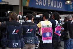 Photographers outside the McLaren garage