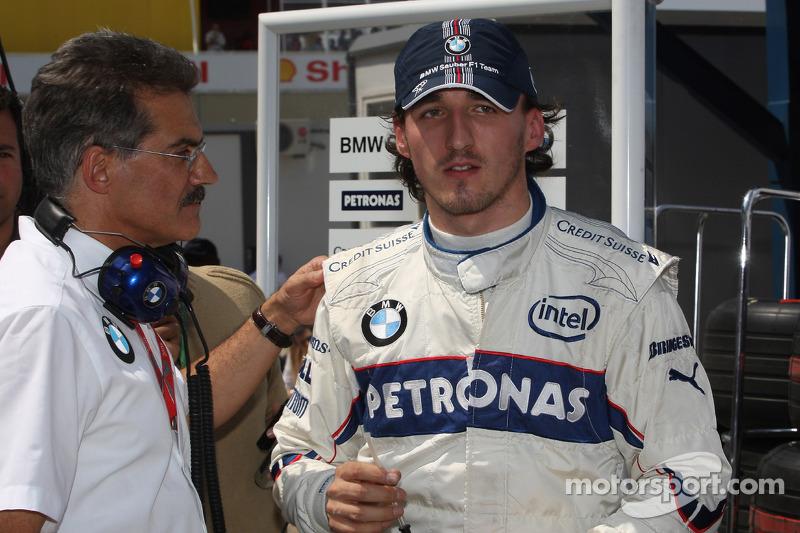 Dr. Mario Theissen, BMW Sauber F1 Team, BMW Motorsport Director and Robert Kubica, BMW Sauber F1 Te