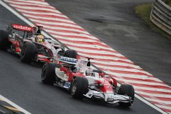 Jarno Trulli, Toyota Racing, TF108 leads Lewis Hamilton, McLaren Mercedes, MP4-23