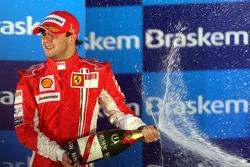 Podium: race winner Felipe Massa sprays champagne