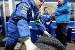 Engineers at work on an Impreza WRC2008 in the SWRT service area