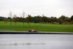 Lewis Hamilton arrives at the McLaren Technology Centre in the McLaren Mercedes MP4-23