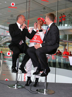Lewis Hamilton on stage with Ron Dennis and Martin Whitmarsh