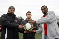 Danielson, Felipe Guimaraes, driver of A1 Team Brazil and Rodrigues at the Chengdu Blades training ground for a friendly football match