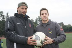 Danielson and Felipe Guimaraes, driver of A1 Team Brazil at the Chengdu Blades training ground for a friendly football match