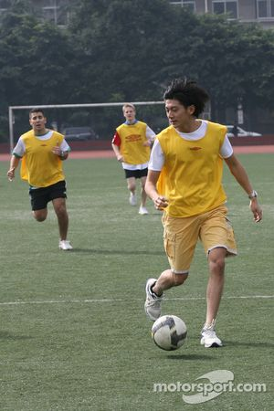 Ho Pin Tung, driver of A1 Team China at the Chengdu Blades training ground for a friendly football match