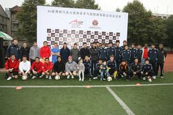 A1 drivers meet the Chengdu Blades at the Chengdu Blades training ground for a friendly football mat