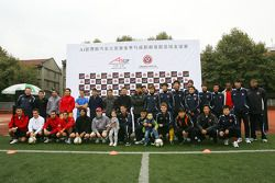 A1GP drivers and the Chengdu Blades at the Chengdu Blades training ground for a friendly football ma