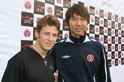 Marco Andretti, driver of A1 Team USA with Li Tie ex Everton football player now current Chengdu Blades player at the Chengdu Blades training ground for a friendly football match