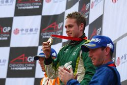 Podium: race winner Adam Carroll