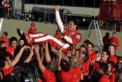 Felipe Massa celebrates with Scuderia Ferrari team members
