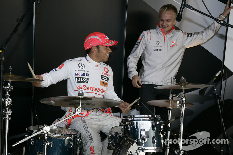 World Champion Lewis Hamilton and his Vodafone McLaren Mercedes team mate Heikki Kovalainen on stage