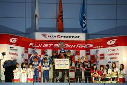 GT300 podium: class winners Nobuteru Taniguchi and Dominik Farnbacher, second place Shinsuke Shibaha