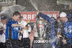 Championship victory lane: 2008 NASCAR Craftsman Truck Series champion Johnny Benson celebrates